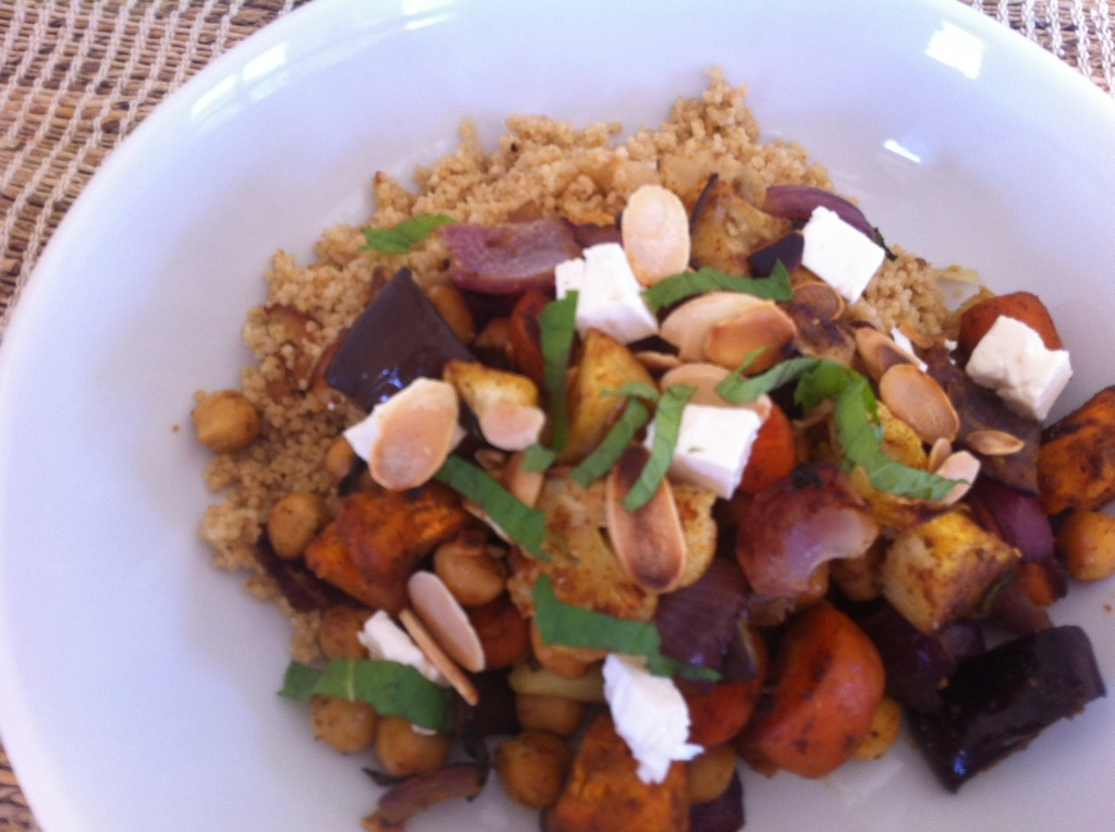 Put the cous cous in a bowl or plate. Top with the roasted vegetables ...